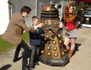 Dalek Invasion of Portsmouth 2013: The Eleventh Doctor, Amy, a Dalek and a boy.