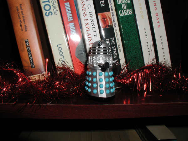 Mr. Dalek on a book shelf