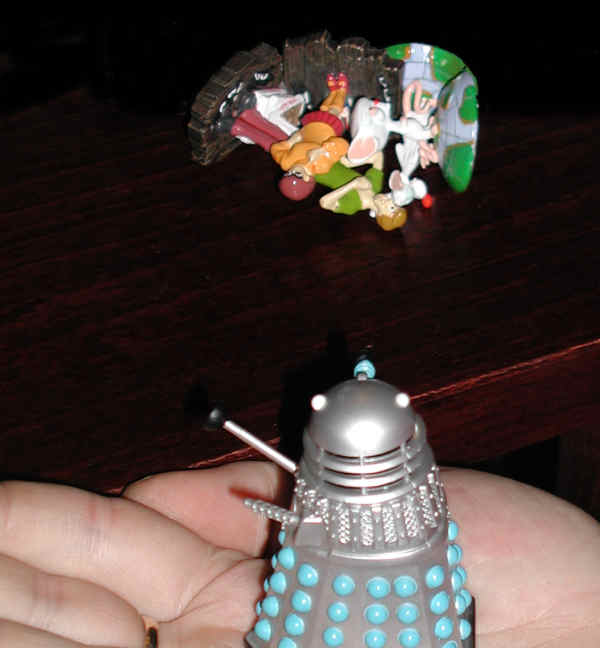 Mr. Dalek looks at the pile of corpses