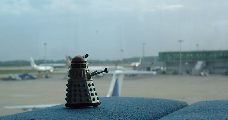 Mr. Dalek looks at the landed aeroplanes